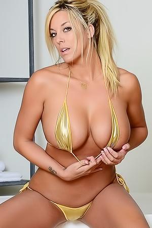 Gisele Poses In Gold Bikini