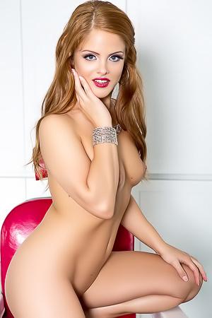 Josee Lanue - nude on a red leather sofa