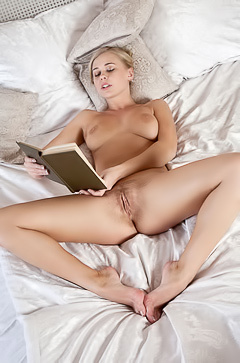 Naked Sarika is reading a book