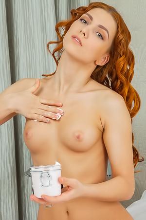 Redhead Corinela and her cream body