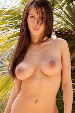 April Oneil is taking off her clothes outdoor