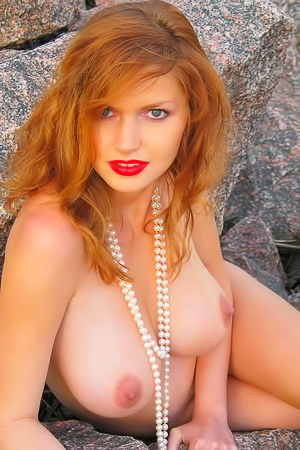 Mature redhead by the sea