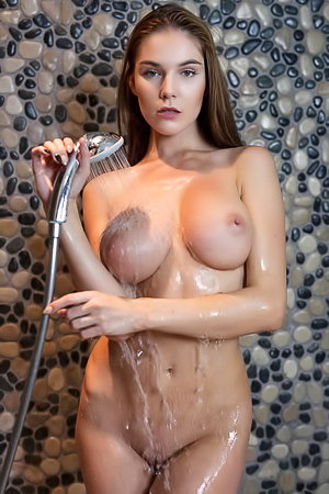 Busty Teen Loraine Taking Shower
