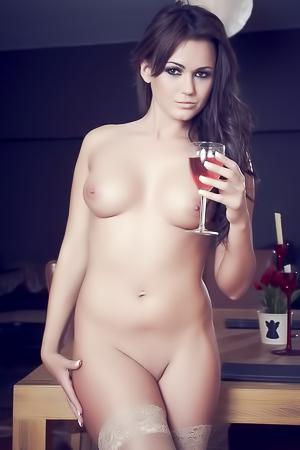 Kat Dee drinking in stockings