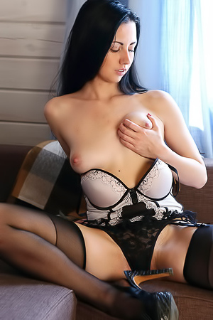 Elegant brunette masturbating in lingerie