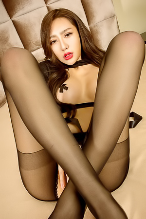 Sweet asian babe in stockings