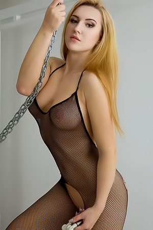 Horny Sandy E in sexy fishnet