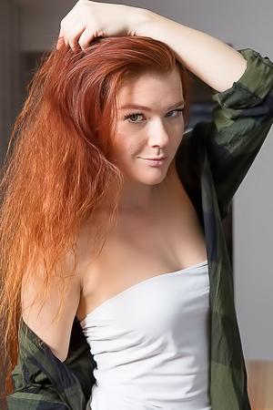 Redhead Mia Sol slowly stripping