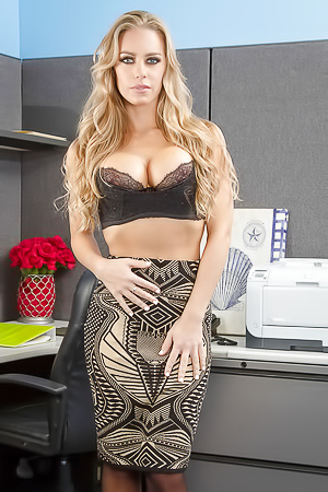 Mature Nicole Aniston strips in office