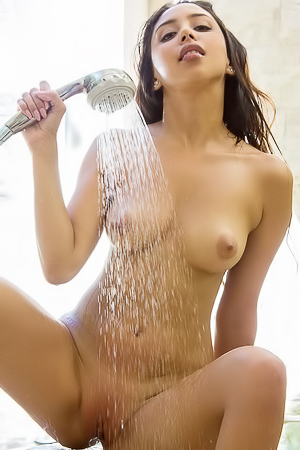 Latina is washing her sexy body
