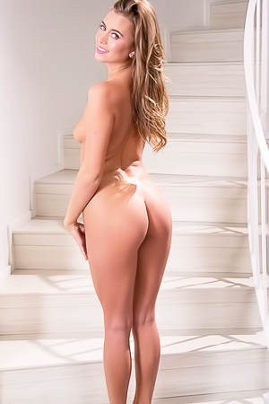 Hot striptease on the stairs