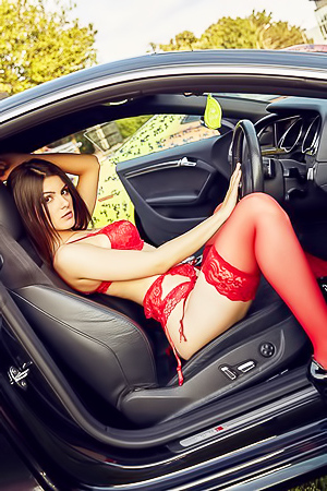 Glamour Eve Thompson strips in a car
