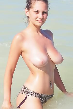 Ruxandra is swimming topless