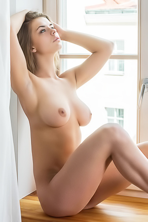 Yelena - naked beauty by the window
