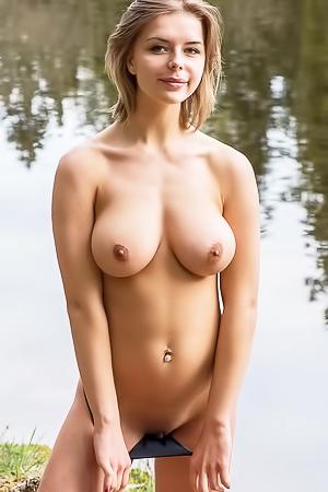 Busty Yelena is fishing topless