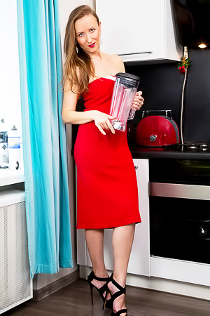 Mature Solena in tight red dress