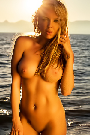 Brittie - busty blonde on the beach