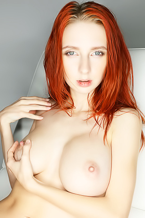 Busty redhead hottie Helga Grey