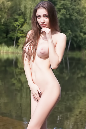 Beautiful busty Freda on the lake