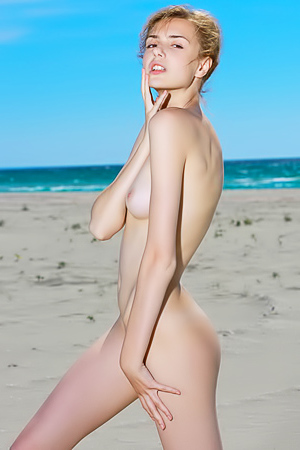 Skinny Elle Tan - naked on the beach