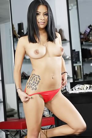 Juicy Latin girl Monica Asis stripping