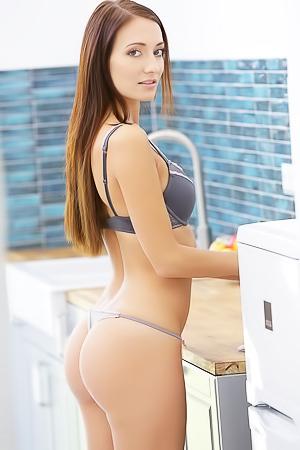 Super hot babe stripping in kitchen