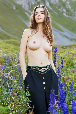 Busty Brunette Girl Posing Among The Mountains