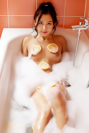 Glamour asian girl taking bath