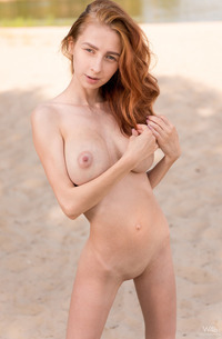 Slim And Busty Redhead Helga Grey